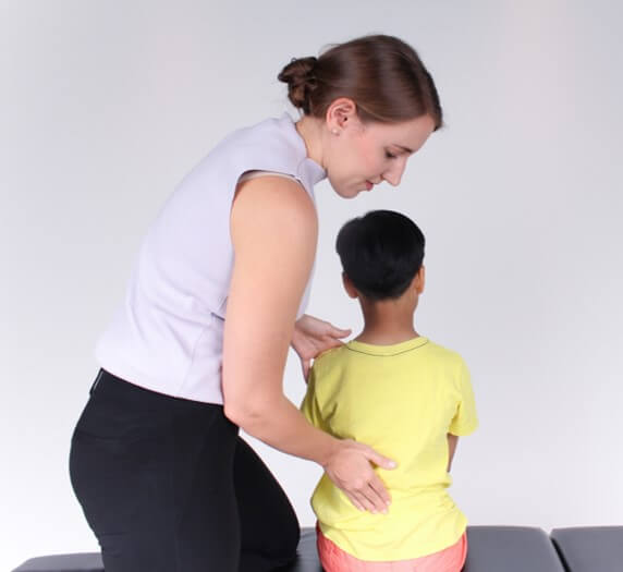 scoliosis-chiropractor-and-child